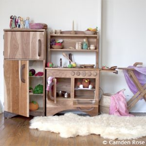 Wooden kitchen set, ironing board, and sheepskin rug for the natural playroom. Made in the USA!