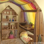 A magical hideaway for children is made by using rainbow play silks on the canopy of our natural wooden playstands. Made in the USA, a natural toy to stimulate creativity in the natural playroom.