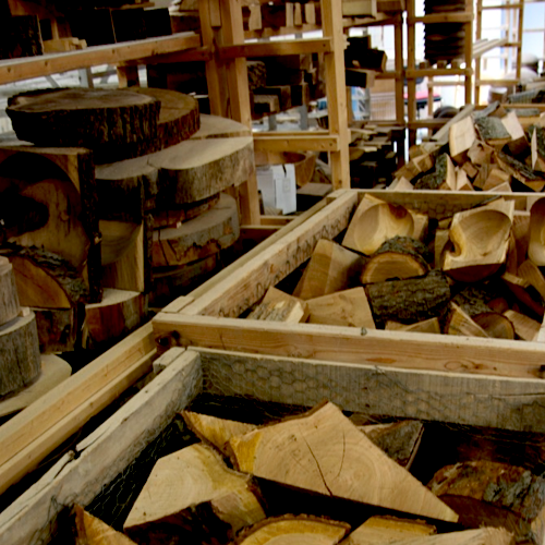 Bits of hardwood cuts in one of our toymaker's shops. Our toys begin and end with natural, nontoxic materials.